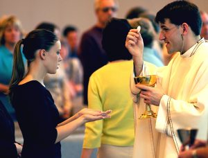Girl receiving Eucharist